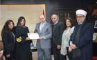 الهباش يمنح محامية مسيحة شهادة مزاولة مهنة بالقضاء الشرعي الإسلامي