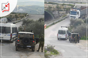 مركبة عسكرية لقوات الاحتلال توقف مركبة تابعة للشرطة على حاجز