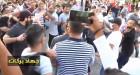 اعتداء رجل أمن بزي مدني على الزميلة نجلاء زيتون التي ترتدي زي الصحافة بشكل واضح